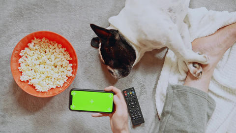 man eating popcorn play game indoors Live Action