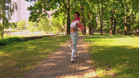 joyful student walking outdoors Live Action