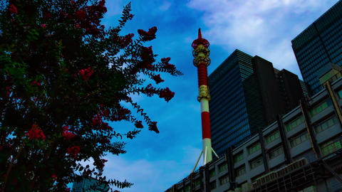 A timelapse of cloud at the business town in Tokyo wide shot zoom GIF