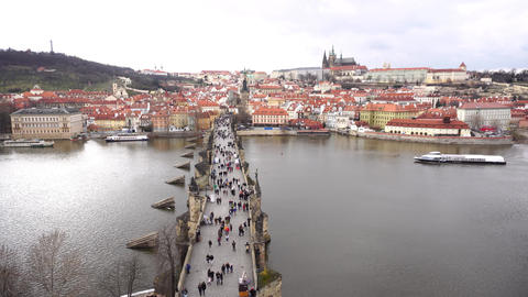 Charles Bridge with people on it from above with boat GIF