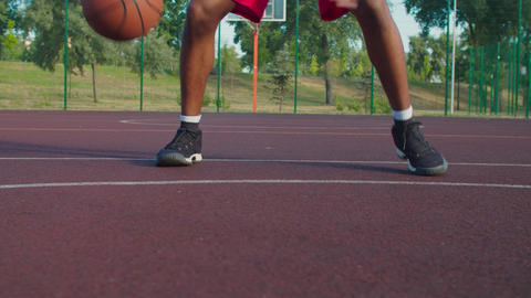 Basketnball player training on outdoor court GIF