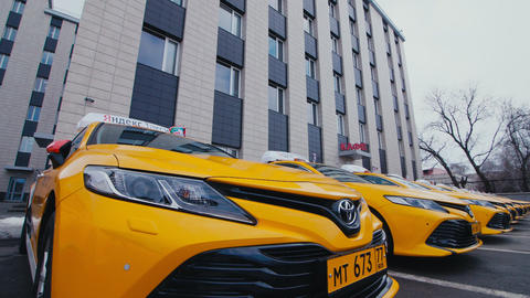Yandex taxi cars stand on parking area near office building ライブ動画