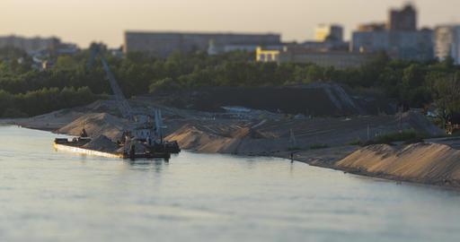 barge crane works at bank near river tilt-shift ライブ動画