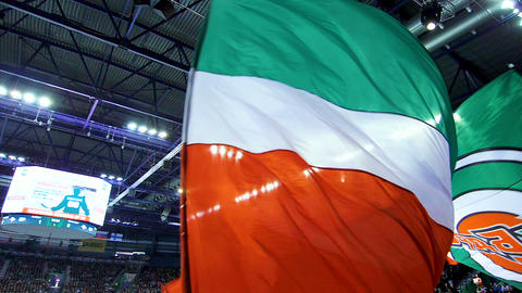 green white and red flag of hockey team waved at match GIF