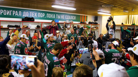 participants of winner hockey team splash champagne in hall GIF