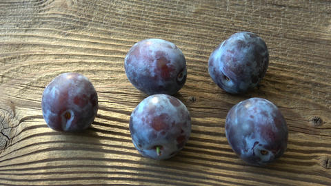 Fresh plums, plum on a wooden table GIF