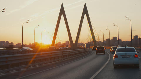cars drive along decorated Millennium bridge in modern city ライブ動画