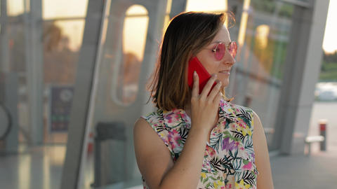 Girl wearing trendy sunglasses uses her phone. Using smartphone for call, talk ライブ動画