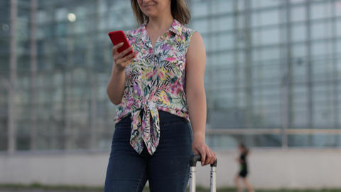 Girl wearing trendy sunglasses uses her phone. Using smartphone for call, talk Live Action