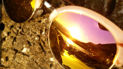 Close-up of the reflection of the sea in sunglasse ビデオ