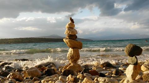 Pyramid of stones on the seashore Footage