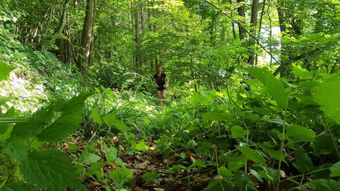 A Woman Running in A Forest Trail GIF