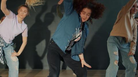 Creative dancers enjoying modern dance performance in dark room dancing and Acción en vivo