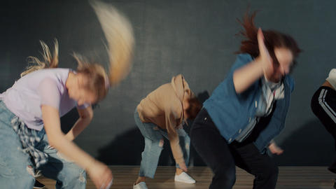 Slow motion of creative youth dancing in dark hall during indoor performance Live Action