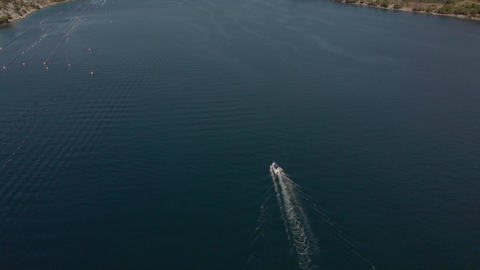 Motor boat moves along long sea bay of Adriatic Sea. Aerial of Croatia GIF