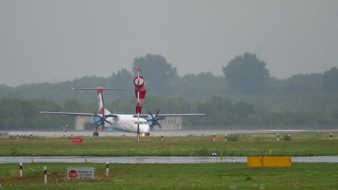 Turboprop plane taxiing at rainy weather GIF