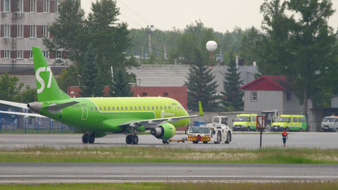 S7 Airlines Embraer 170 towing GIF