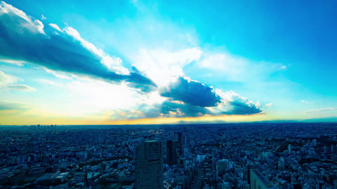 A timelapse of panoramic cityscape in Tokyo high angle wide shot panning GIF