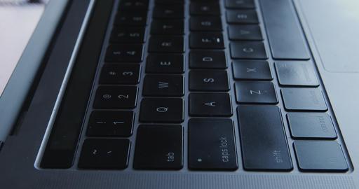 Gray modern Laptop Keyboard close-up dolly shot Live Action