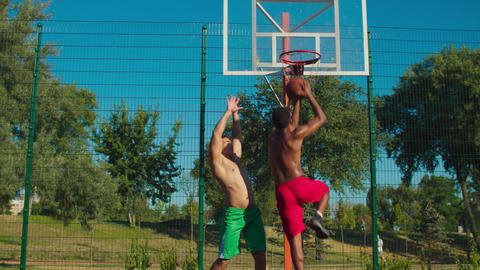 Basketball player scoring points over defender GIF