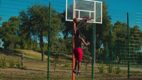 Basketball player scoring after teammate assist GIF