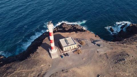 Scenic aerial view of a Lighthouse in volcanic coastline landscape. Tenerife Acción en vivo