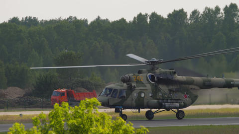 Military helicopter on runway GIF