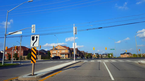 Driving Approaching Red Light Intersection With Traffic Passing By. Driver Point of View POV Urban Live Action