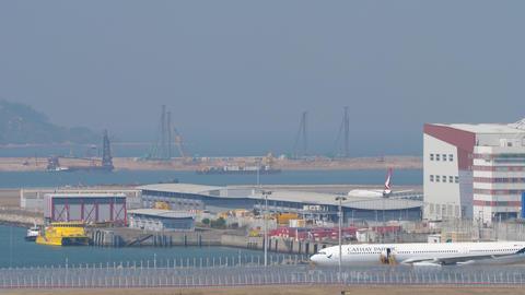 Airliner landing at International Airport, Hong Kong GIF