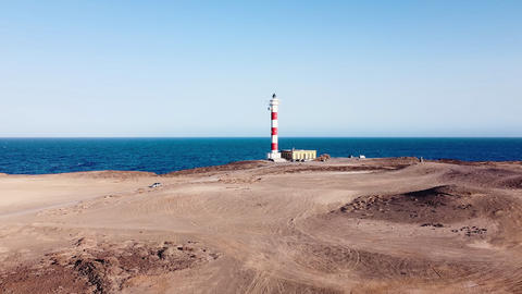 Scenic aerial view of a Lighthouse in volcanic coastline landscape. Tenerife GIF