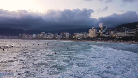 Ipanema, Rio De Janeiro Brazil. Surfers and Buildings, Beachfront and Cloudy Sky Acción en vivo