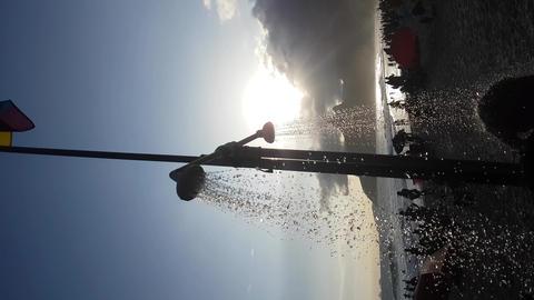 Vertical Video of Ipanema Beach, Rio De Janeiro, Brazil. Shower Water Silhouette Acción en vivo