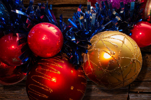 New Year and Christmas decoration balls closeup view on wooden b Photo