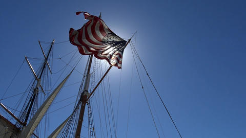 American flag on a sailing frigate. San Diego Footage