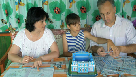 The family at the table playing a game Footage