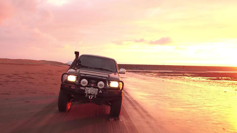 ride in the beach with sunset Footage