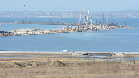 Taman, Russia - November 5, 2016: Construction of a bridge across the Kerch Stra Footage