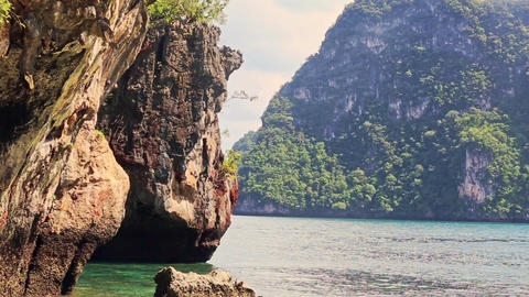 Rocky Cliff Green Cliffy Islands in Azure Tropical Sea Footage