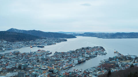 Sunset over the city. Bergen, Norway. Zoom. TimeLapse Footage
