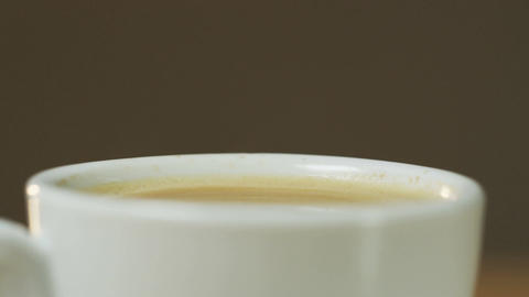 A Cup Full of Coffee Moves From Left to Right Footage