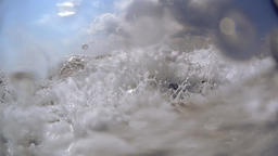 Gentle waves rolling over wavebreaker in slow motion Footage