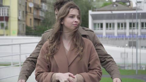 Middle shot of loving romantic man hugging girlfriend outdoors. Portrait of Acción en vivo