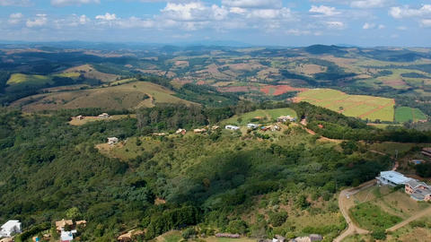 Aerial view of valley with farm field, forest and villa in tropical country Live Action
