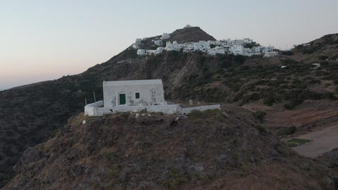 Flight over Small Town Church on Greek Island Milos at Dusk Live Action