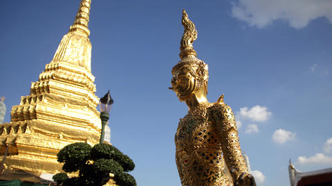 Golden statue at Grand Palace Temple in Bangkok Live Action