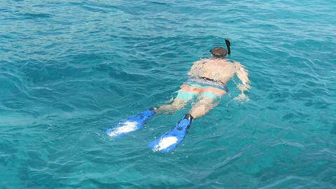 Snorkelling in the clear turquoise water Footage
