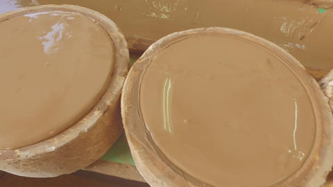 Pour the clay from the plaster form. Production of plates Footage