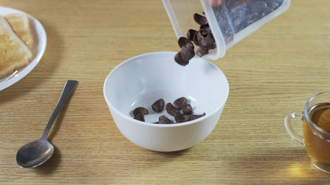 Putting Chocolate Flakes Into a Bowl Footage