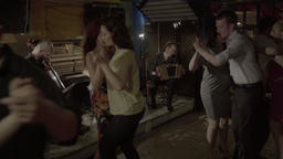 A lot of people dancing in the evening in a cafe Footage