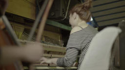 The hand of the musician with a bow while playing the cello Footage